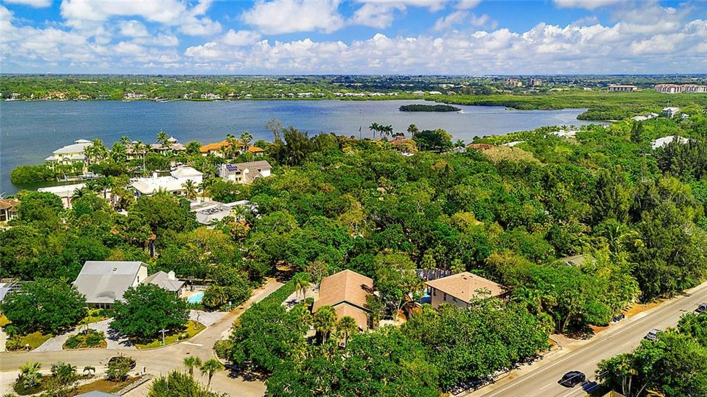 Siesta Key and Grand Bay. - Single Family Home for sale at 1302 Roberts Bay Ln, Sarasota, FL 34242 - MLS Number is A4433097