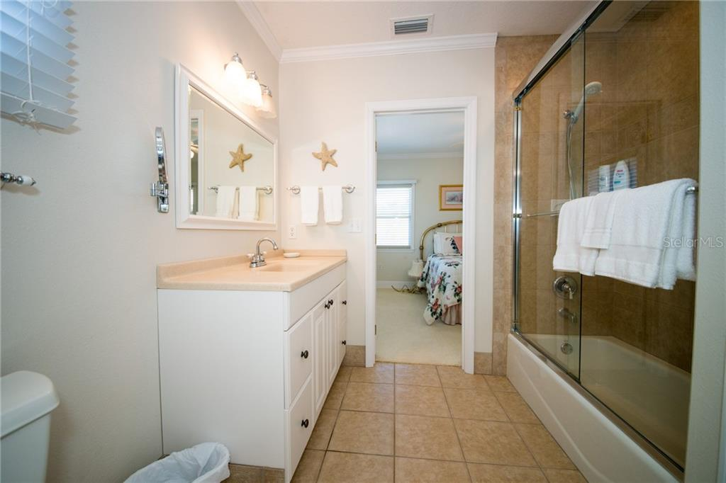 Guest Bath on the 3rd level has tub & shower.  Can enter from each bedroom - Single Family Home for sale at 2405 Avenue A, Bradenton Beach, FL 34217 - MLS Number is A4433128