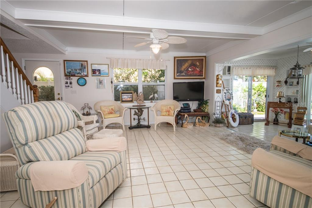 First level Great Room - Single Family Home for sale at 2405 Avenue A, Bradenton Beach, FL 34217 - MLS Number is A4433128