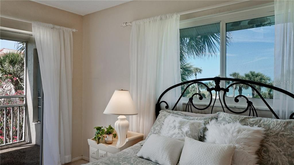 Master bedroom with ensuite bathroom. New window over bed, view of beach at end of North Shore Road. - Condo for sale at 7145 Gulf Of Mexico Dr #24, Longboat Key, FL 34228 - MLS Number is A4433880