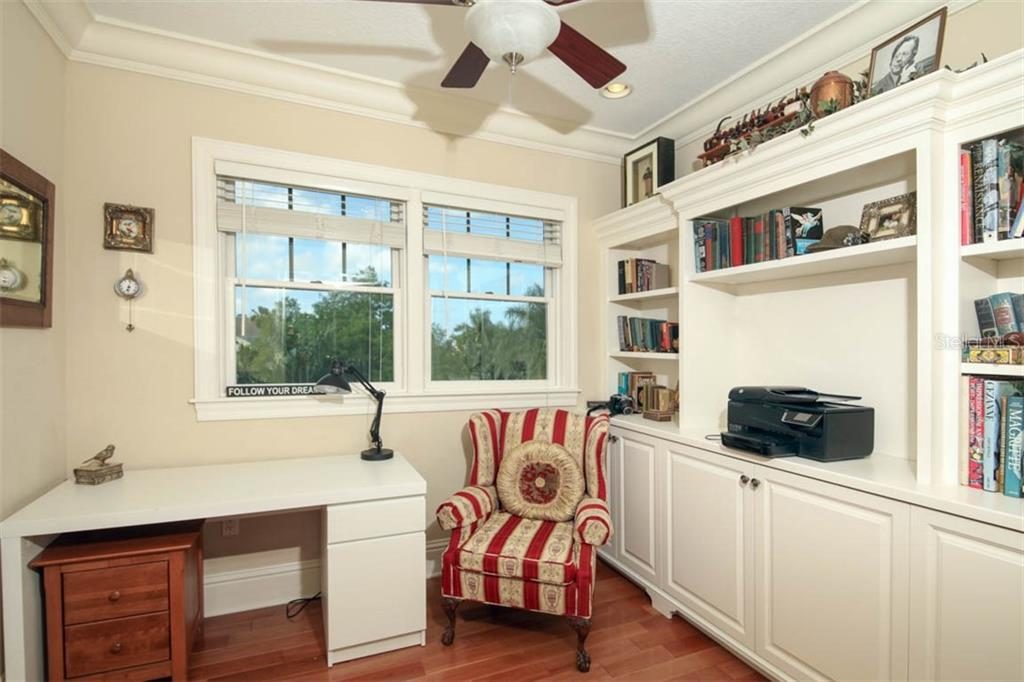 Office/den/nursery on 3rd level, with storage closet and built-ins and pocket doors. - Single Family Home for sale at 7153 Hawks Harbor Cir, Bradenton, FL 34207 - MLS Number is A4434661
