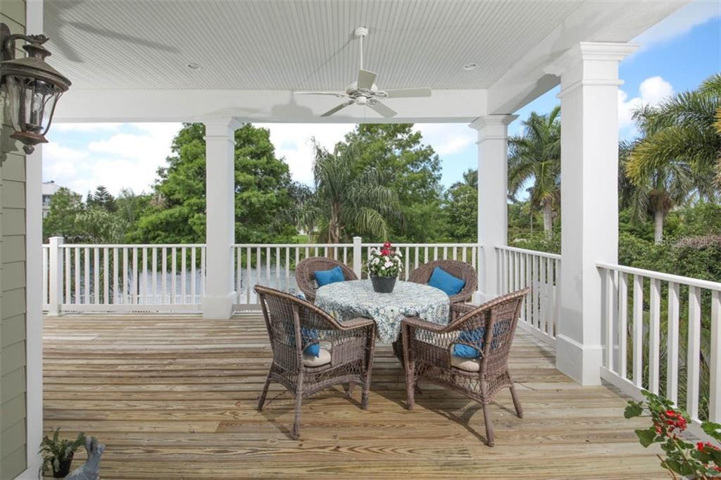 Back porch overlooking the pool and pond. - Single Family Home for sale at 7153 Hawks Harbor Cir, Bradenton, FL 34207 - MLS Number is A4434661