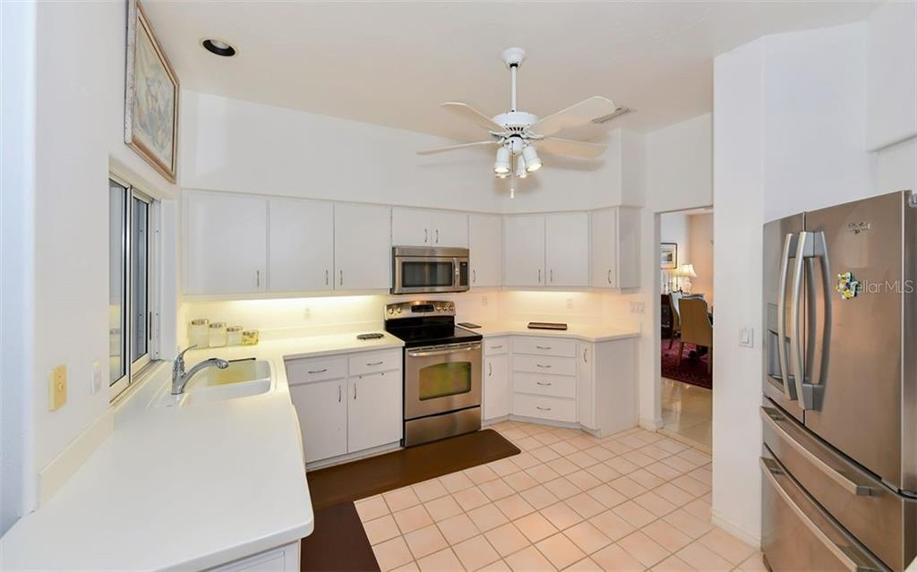 kitchen with entry to dining room - Single Family Home for sale at 5401 Downham Meadows, Sarasota, FL 34235 - MLS Number is A4436577