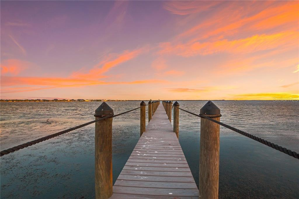 Long view of the composite dock takes you right into the sunset! - Single Family Home for sale at 590 Bayshore Dr, Terra Ceia, FL 34250 - MLS Number is A4437024