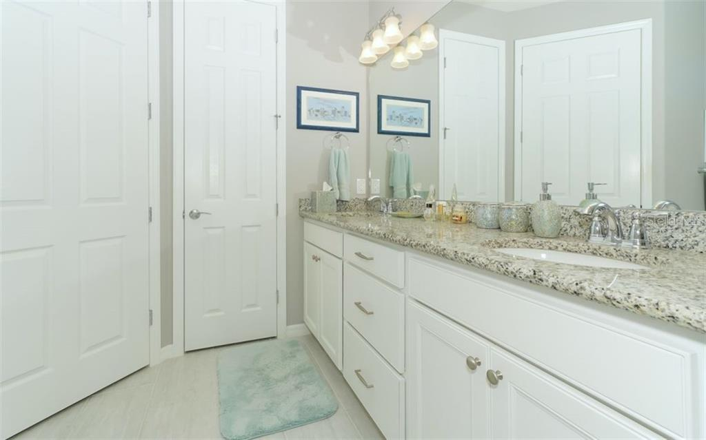 Matching granite in master bath - Single Family Home for sale at 13337 Pacchio St, Venice, FL 34293 - MLS Number is A4437569