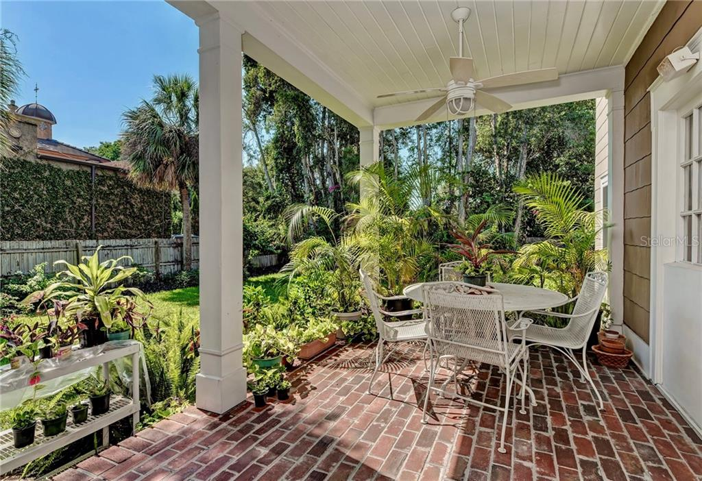 Outdoor dining on this classic open porch. - Single Family Home for sale at 813 Hudson Ave, Sarasota, FL 34236 - MLS Number is A4437601