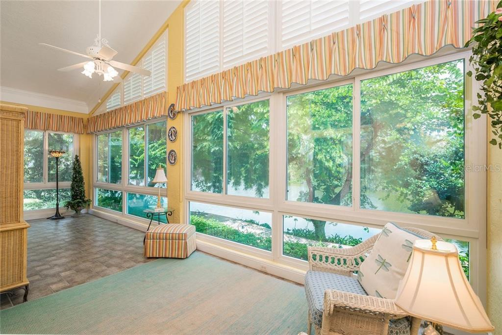 The most lovely Solarium w/ picturesque views of the lake and Floridian garden! - Single Family Home for sale at 3702 Beneva Oaks Blvd, Sarasota, FL 34238 - MLS Number is A4438878