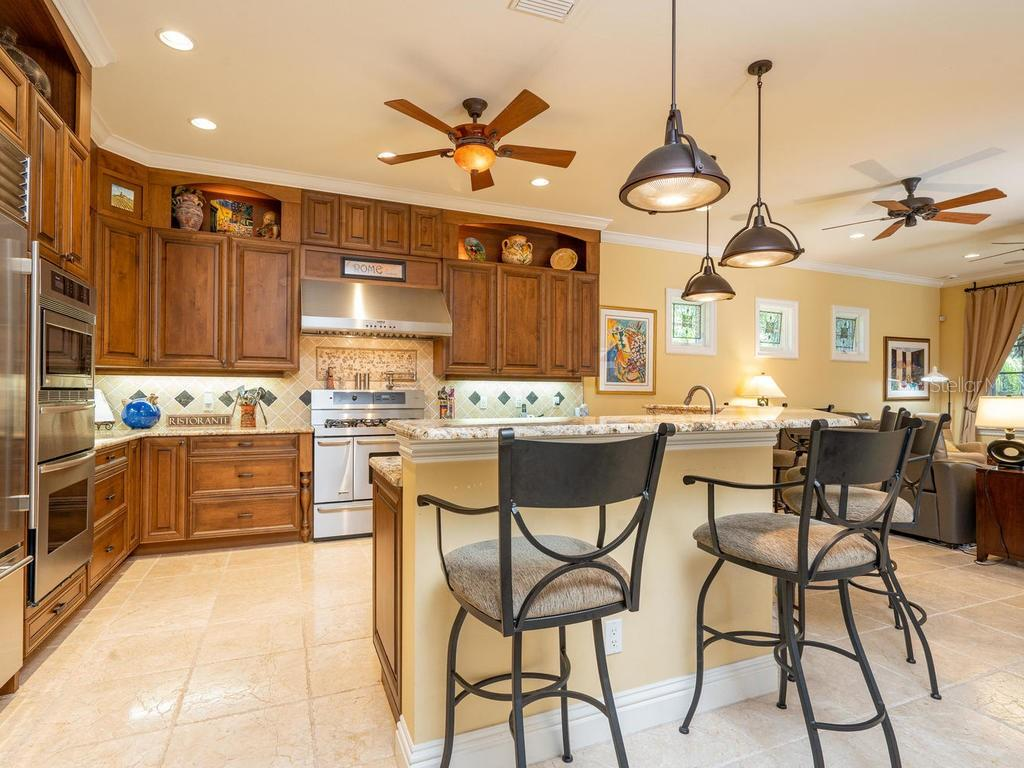 Top of the Line Chef's Kitchen with coffee bar - Single Family Home for sale at 158 Puesta Del Sol, Osprey, FL 34229 - MLS Number is A4439362