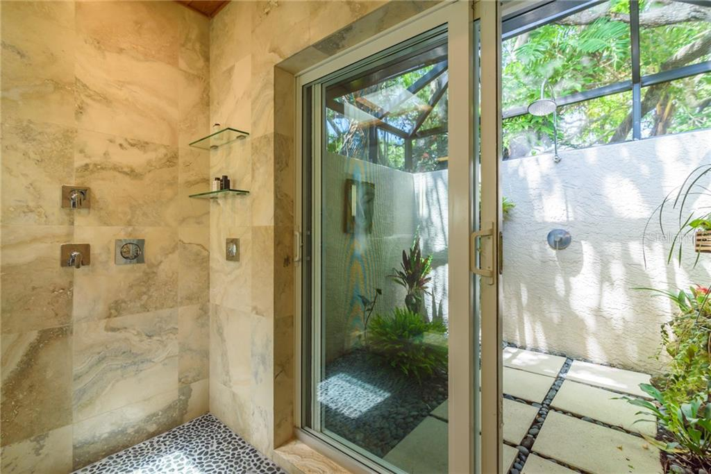 Master shower toward outdoor shower - Single Family Home for sale at 8511 Heron Lagoon Cir, Sarasota, FL 34242 - MLS Number is A4439489