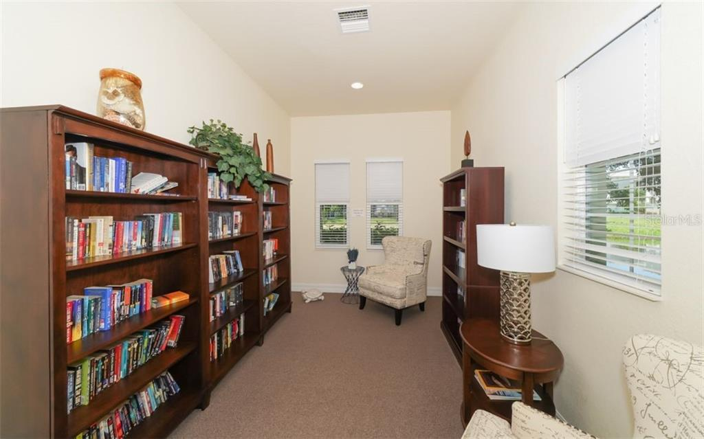 Shared library within clubhouse. - Condo for sale at 200 San Lino Cir #233, Venice, FL 34292 - MLS Number is A4440138