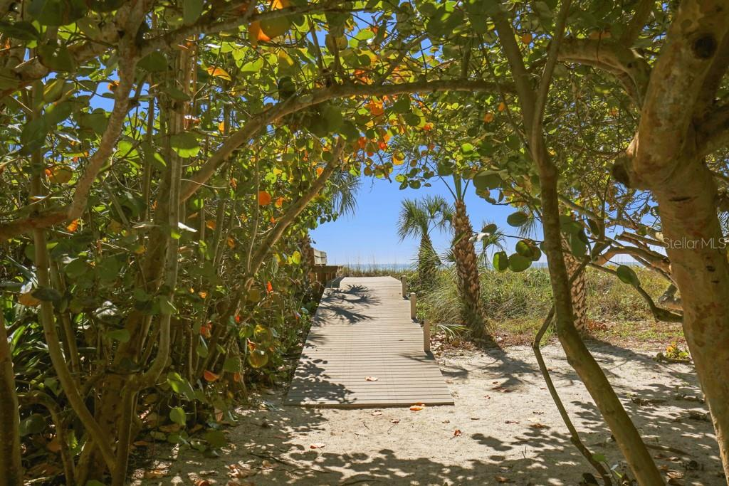 Private boardwalk to the beach on the Gulf of Mexico - Single Family Home for sale at 845 Longboat Club Rd, Longboat Key, FL 34228 - MLS Number is A4440615