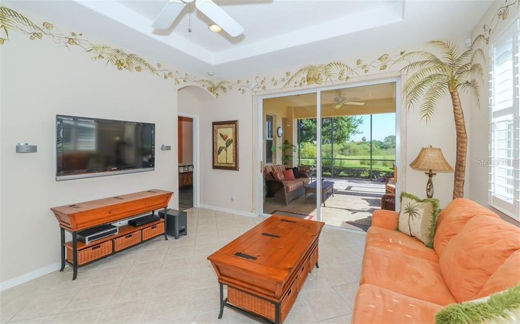 Large living room with access to lanai. - Single Family Home for sale at 114 Padova Way #52, North Venice, FL 34275 - MLS Number is A4442496