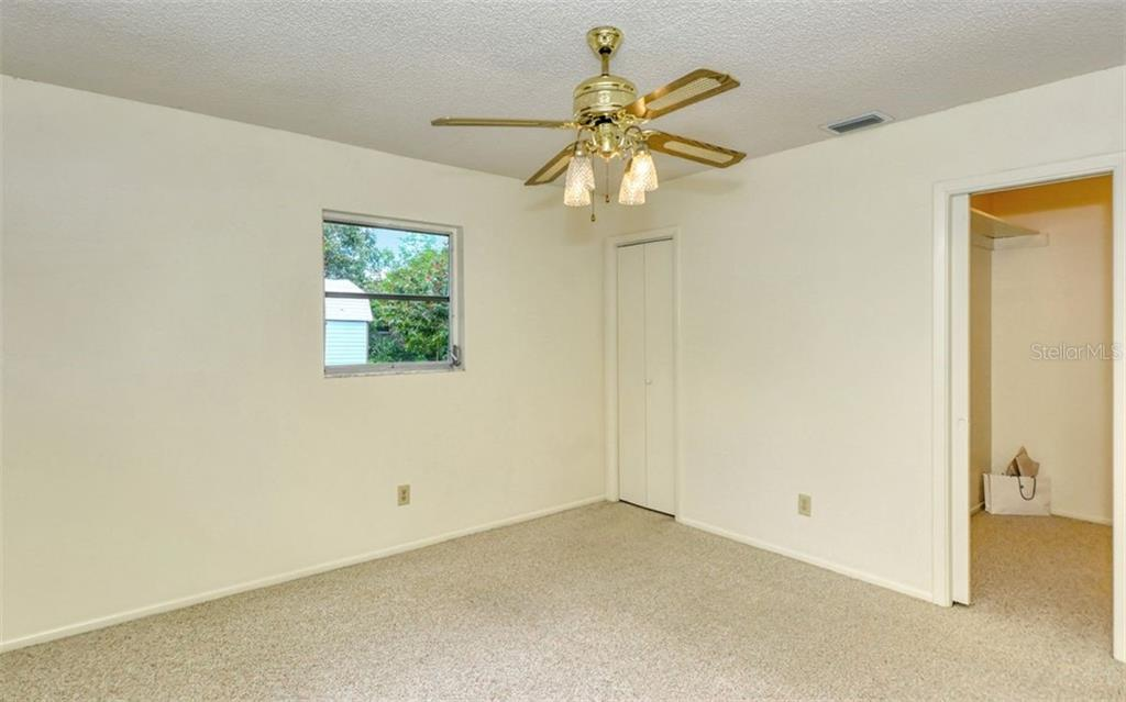 The master suite is large and bright and offers a spacious walk in closet and private full bath. - Single Family Home for sale at 3286 Jamestown St, Port Charlotte, FL 33952 - MLS Number is A4444310