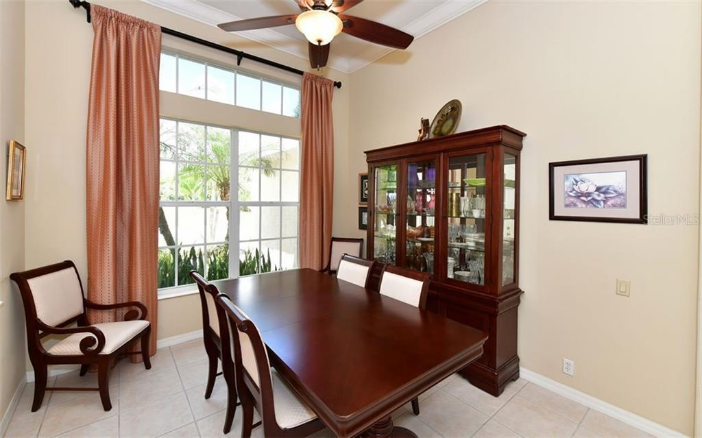 Great room shot including dinette area with triple sliders-this home is wired for sound! - Single Family Home for sale at 13022 Peregrin Cir, Bradenton, FL 34212 - MLS Number is A4444939