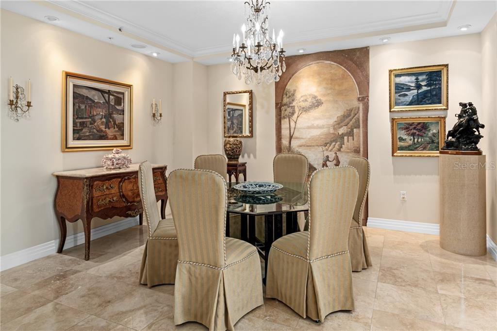 Formal dining room, most floor plans in the building do not offer this space. - Condo for sale at 401 S Palm Ave #402, Sarasota, FL 34236 - MLS Number is A4446224