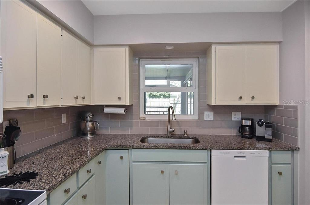 Kitchen - Single Family Home for sale at 105 Alba St E, Venice, FL 34285 - MLS Number is A4446473