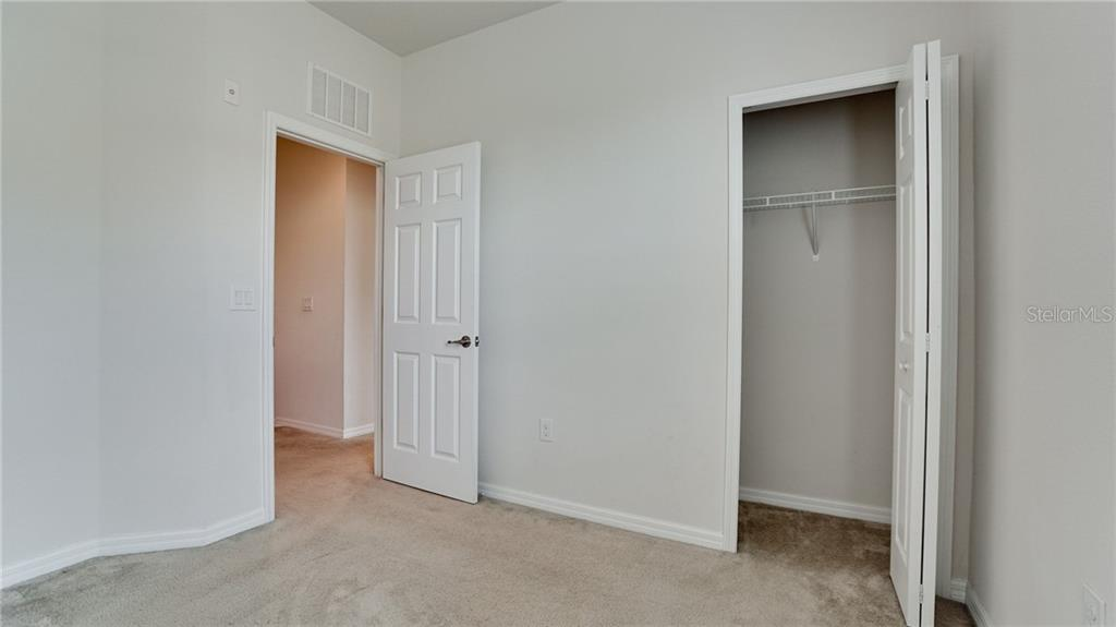 Guest bedroom #2 with nice size closet - Condo for sale at 7815 Moonstone Dr #24-204, Sarasota, FL 34233 - MLS Number is A4446867