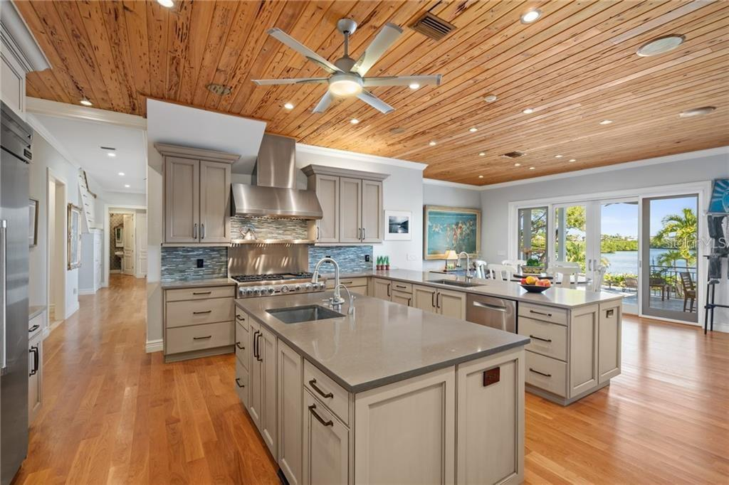 Custom kitchen. - Single Family Home for sale at 711 Mangrove Point Rd, Sarasota, FL 34242 - MLS Number is A4447637
