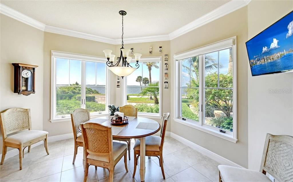 Eat-in space in kitchen - Single Family Home for sale at 7903 Longbay Blvd, Sarasota, FL 34243 - MLS Number is A4449717