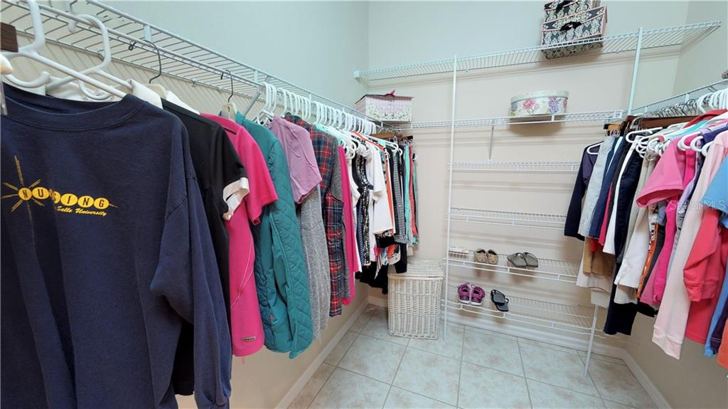Hers walk-in closet - Single Family Home for sale at 7288 Lismore Ct, Lakewood Ranch, FL 34202 - MLS Number is A4449934