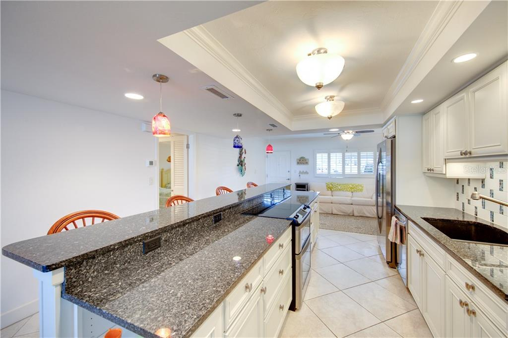 Another view of the kitchen from the edge of the dining room. - Condo for sale at 555 The Esplanade N #102, Venice, FL 34285 - MLS Number is A4450635