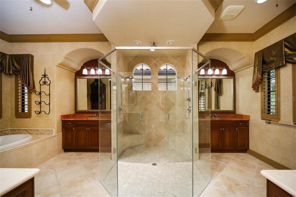 Sumptuous master bath with two separate sinks and two water closets - Single Family Home for sale at 15212 Linn Park Ter, Lakewood Ranch, FL 34202 - MLS Number is A4450793