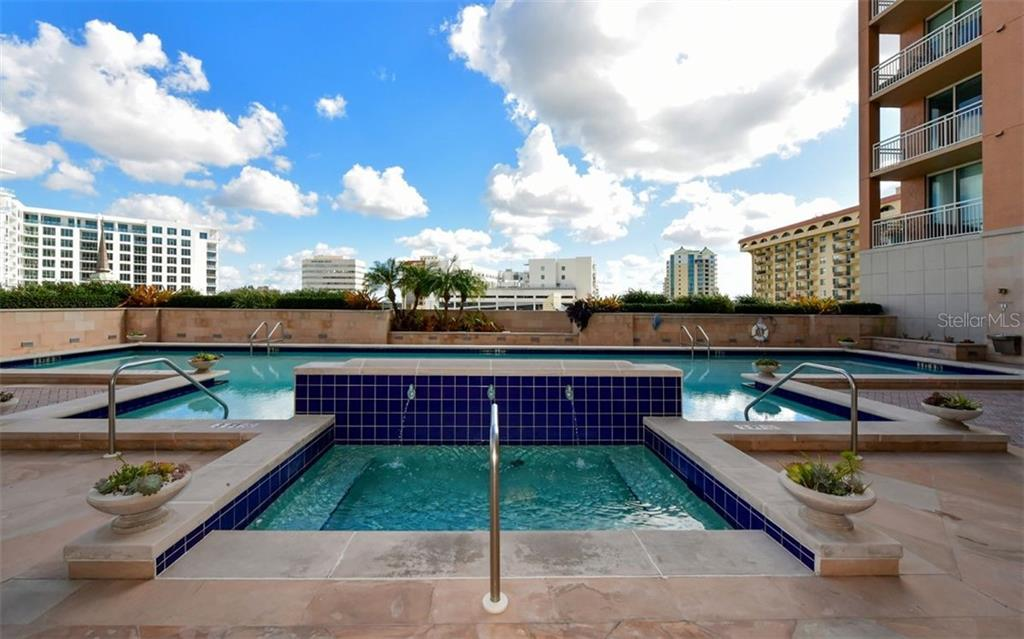 Loungers in the pool area - Condo for sale at 1350 Main St #804, Sarasota, FL 34236 - MLS Number is A4451085