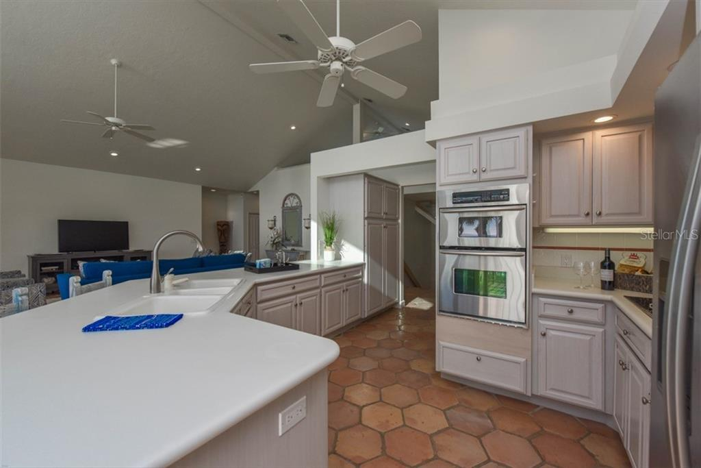 Functional kitchen, with lots of working spaces. - Single Family Home for sale at 1027 N Casey Key Rd, Osprey, FL 34229 - MLS Number is A4451976