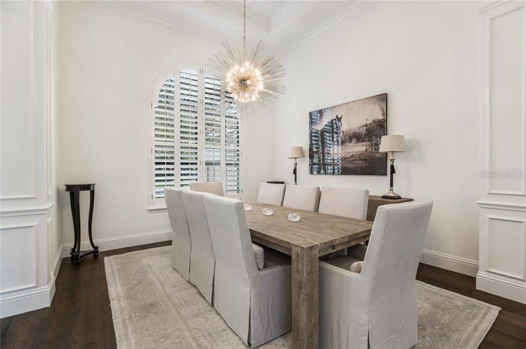 CLASSIC DINING ROOM WITH PLANTATION SHUTTERS, COFFERED CEILING DETAIL AND NEW LIGHTING! - Single Family Home for sale at 12551 Highfield Cir, Lakewood Ranch, FL 34202 - MLS Number is A4452079