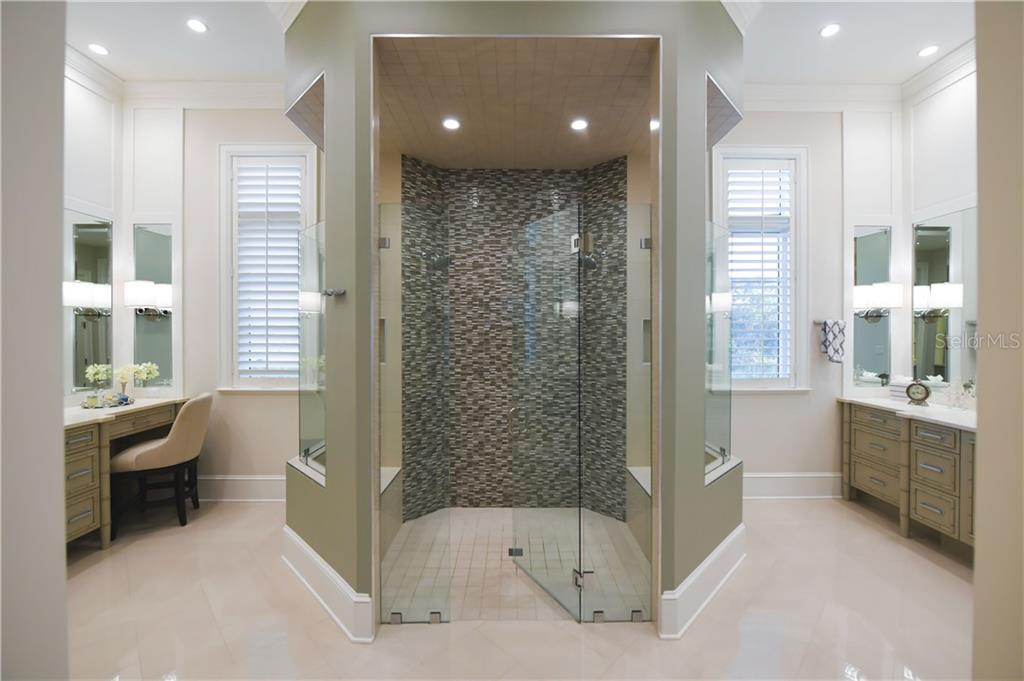 Master Bath complete with His and Her Vanity Areas, His and Her Water Closets and Oversized Center Shower. - Single Family Home for sale at 16119 Baycross Dr, Lakewood Ranch, FL 34202 - MLS Number is A4452632