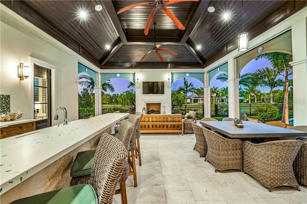 Private and covered outdoor living space complete shell stone pavers, gas fireplace and remote control screens to enclose outdoor living space. - Single Family Home for sale at 16119 Baycross Dr, Lakewood Ranch, FL 34202 - MLS Number is A4452632