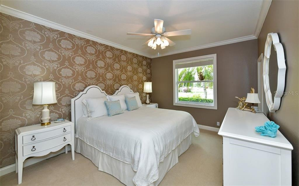 Bedroom 4 - Single Family Home for sale at 574 N Macewen Dr, Osprey, FL 34229 - MLS Number is A4455085