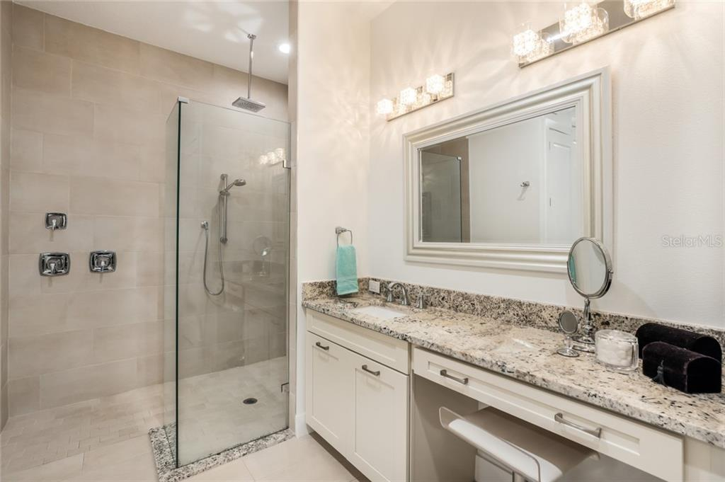Master bath, dual vanities & roman shower with rain shower head. - Single Family Home for sale at 6125 1st Ter E, Palmetto, FL 34221 - MLS Number is A4455618