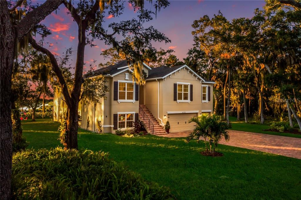 Front view at twilight. - Single Family Home for sale at 6125 1st Ter E, Palmetto, FL 34221 - MLS Number is A4455618