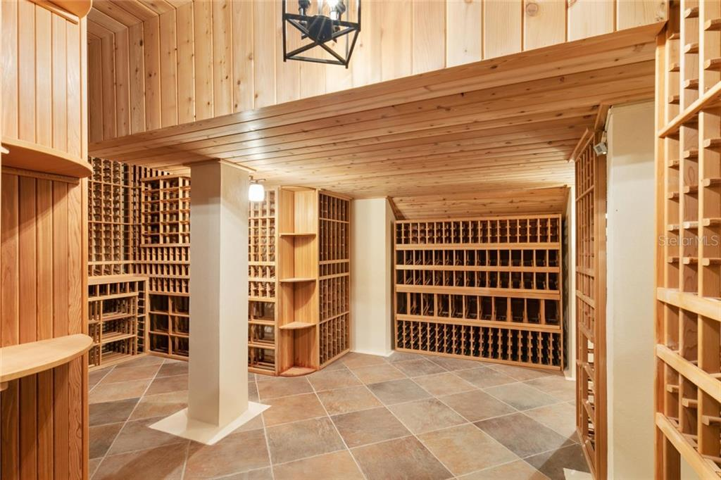 Cedar wine cellar holds 5,000+ bottles and is dual temperature controlled for both red and white wines. - Single Family Home for sale at 901 Norsota Way, Sarasota, FL 34242 - MLS Number is A4456224