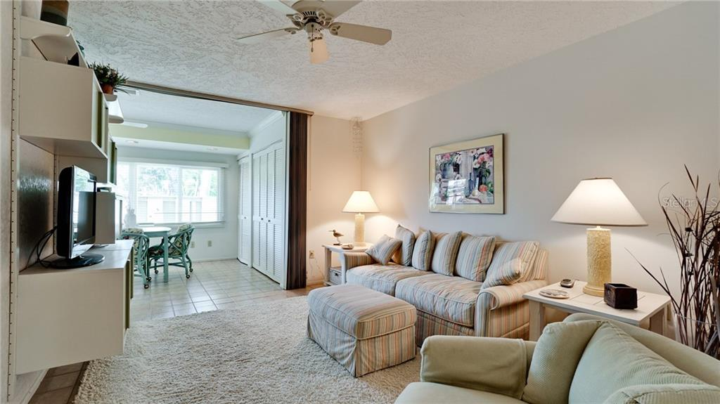 2nd BEDROOM CURRENTLY USED AS DEN WITH PULL OUT COUCH FOR GUESTS. CABINETS ON WALL COULD BE REMOVED. TILED FLOOR IN THIS ROOM AS WELL AS ENTRY ROOM, HALLWAY & KITCHEN. - Condo for sale at 6700 Gulf Of Mexico Dr #116, Longboat Key, FL 34228 - MLS Number is A4456442