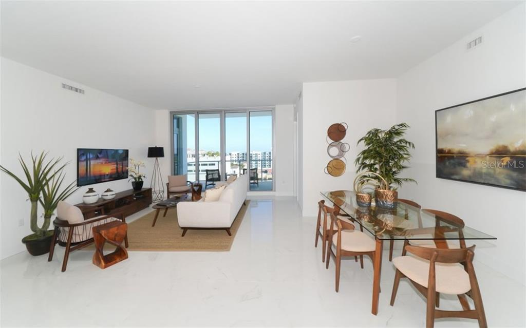 Open living room & dining area. - Condo for sale at 111 S Pineapple Ave #1117 L-1, Sarasota, FL 34236 - MLS Number is A4461778