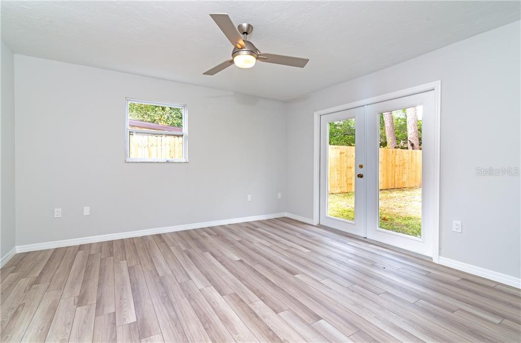 Master Bedrooms with French Doors leading to your large backyard. - Single Family Home for sale at 5057 Bell Meade Dr, Sarasota, FL 34232 - MLS Number is A4461883