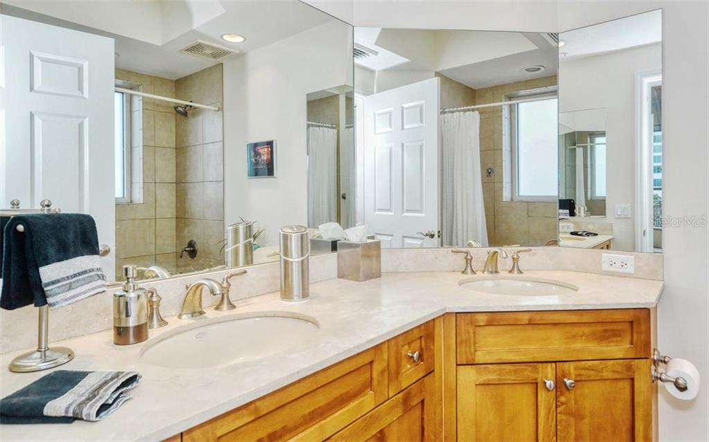 Master bath with dual sinks - Condo for sale at 100 Central Ave #A401, Sarasota, FL 34236 - MLS Number is A4463296
