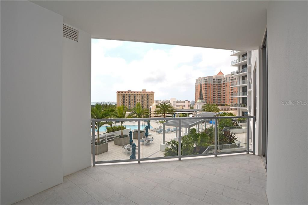 Terrace views of the community pool, Sarasota Bay in the distance and city skyline. - Condo for sale at 111 S Pineapple Ave #610, Sarasota, FL 34236 - MLS Number is A4463717