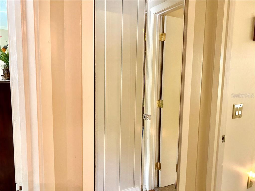 Mirrored linen closet, first bedroom to the left, second bedroom and changing room to the right. - Single Family Home for sale at 4300 Eastern Pkwy, Sarasota, FL 34233 - MLS Number is A4464200