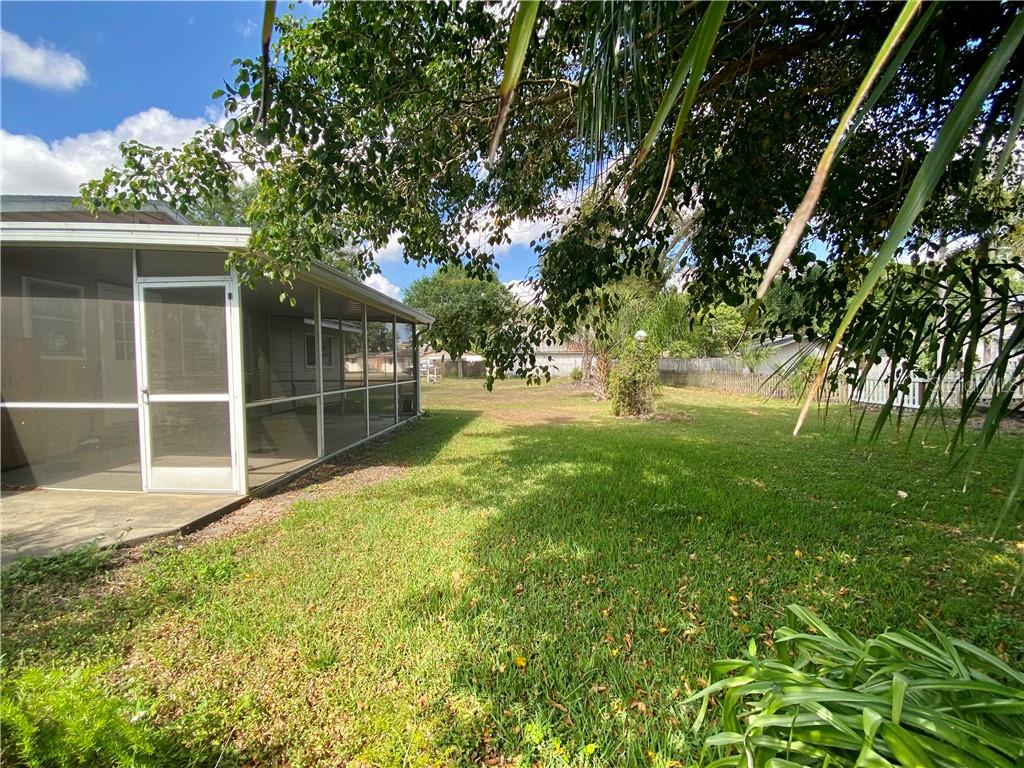 Right side of the yard.  View from the front of the house. - Single Family Home for sale at 4300 Eastern Pkwy, Sarasota, FL 34233 - MLS Number is A4464200