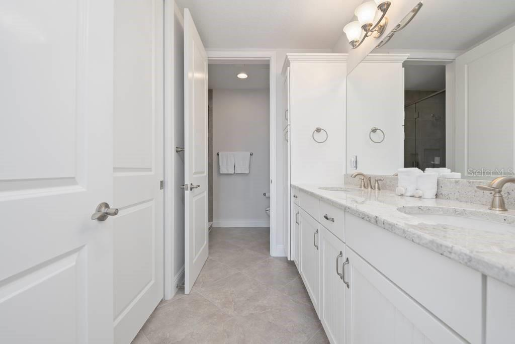Master bath with dual vanities. - Condo for sale at 383 Aruba Cir #201, Bradenton, FL 34209 - MLS Number is A4466540