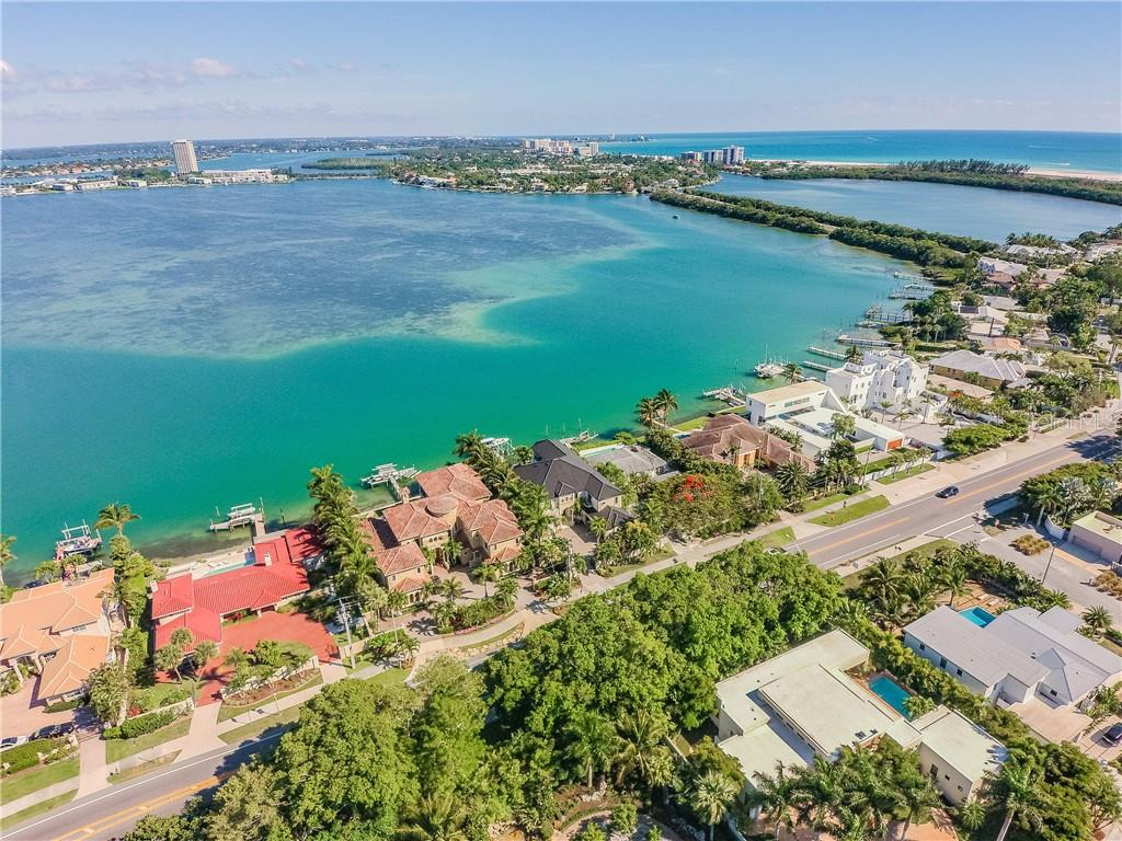 Middle house/dark roof with boat on lift, view towards St Armand's Circle, Lido Beach - Single Family Home for sale at 1418 John Ringling Pkwy, Sarasota, FL 34236 - MLS Number is A4467093