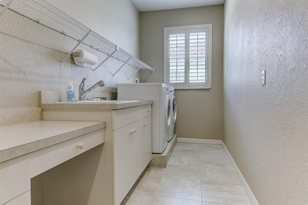 Laundry room - Single Family Home for sale at 4338 Corso Venetia Blvd, Venice, FL 34293 - MLS Number is A4467578