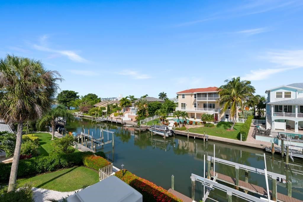 New seawall and 20,000 lb. boat lift - Single Family Home for sale at 605 N Point Dr, Holmes Beach, FL 34217 - MLS Number is A4469001
