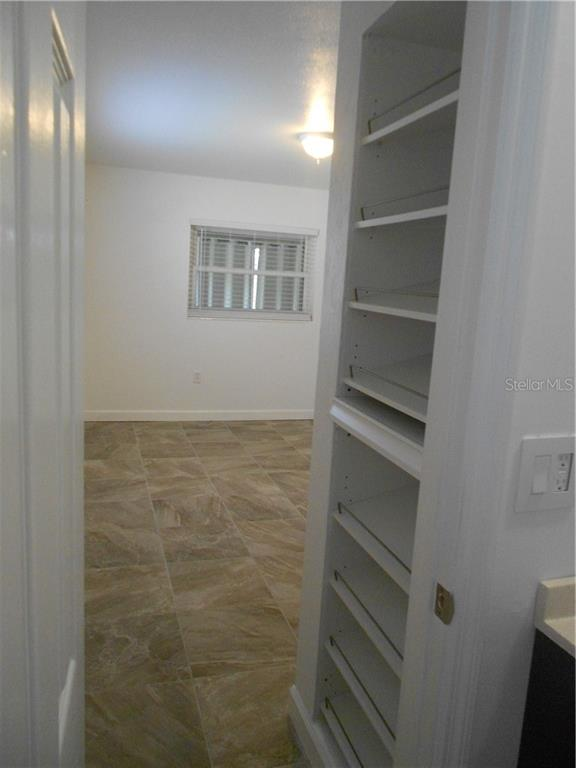 Master Hall with Built-in Shoe Shelves - Single Family Home for sale at 5326 Colewood Pl, Sarasota, FL 34232 - MLS Number is A4471495