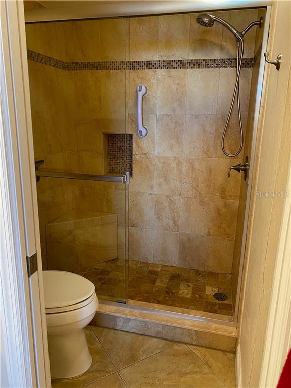 The master bath has pocket door to separate the toilet and walk in shower. - Condo for sale at 5770 Midnight Pass Rd #509c, Sarasota, FL 34242 - MLS Number is A4472645