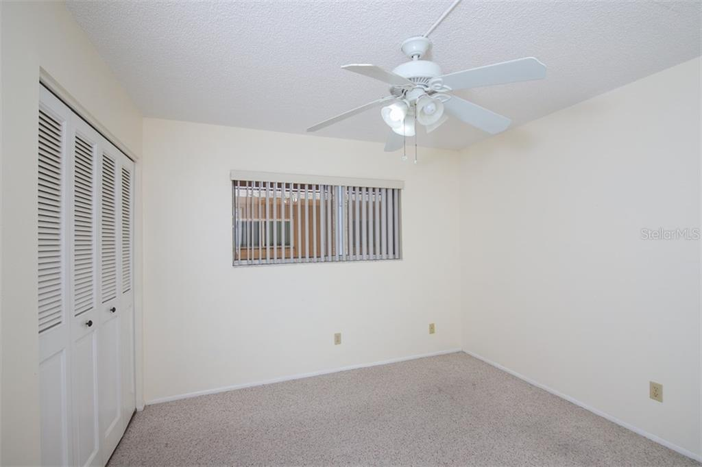 2nd bedroom with wall closet. - Condo for sale at 1330 Glen Oaks Dr E #171d, Sarasota, FL 34232 - MLS Number is A4473999