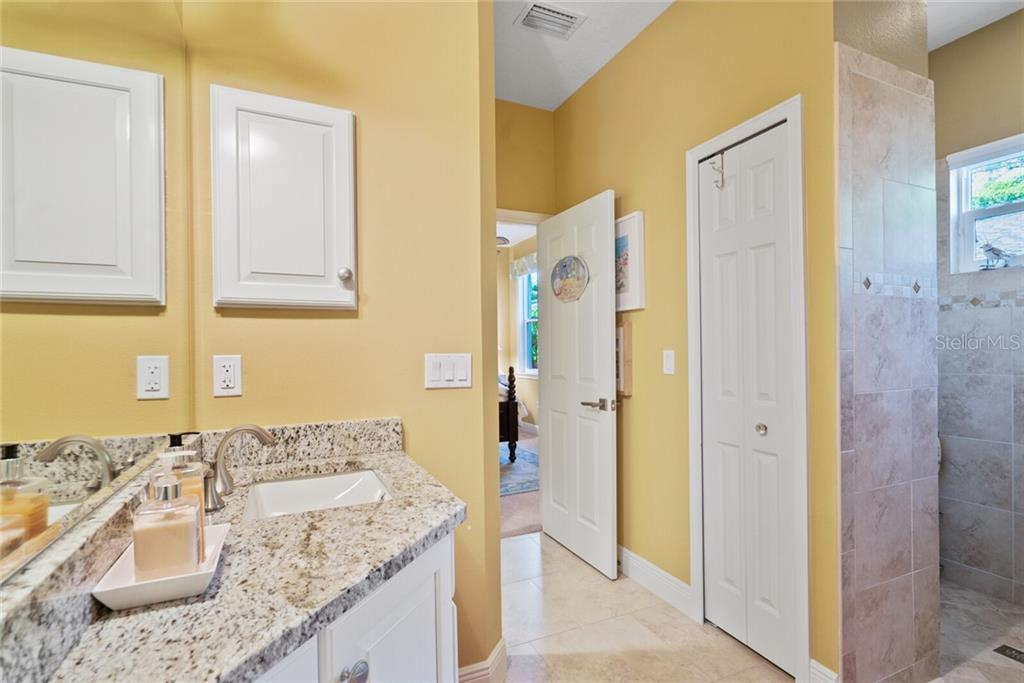 Guest bathroom with access from kitchen area and guest room - Single Family Home for sale at 1907 Clematis St, Sarasota, FL 34239 - MLS Number is A4474600
